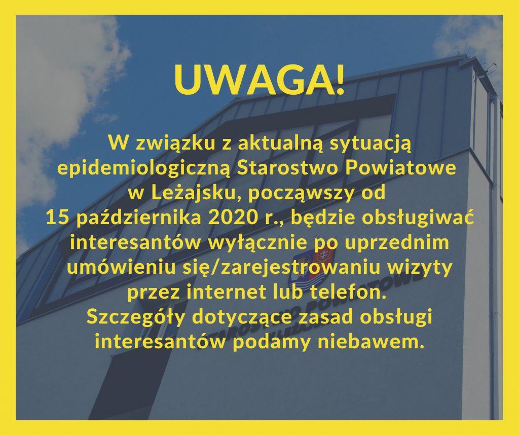 Grafika z budynkem starostwa jako tłem, na którym umieszczono komunikat. Litery oraz ramka okalająca grafikę mają kolor intensywnie żółty.